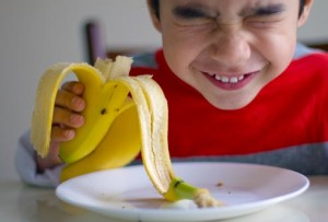 getty_rf_photo_of_boy_eating_banana