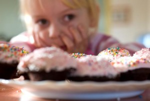 getty_rm_photo_of_child_looking_at_cupcakes